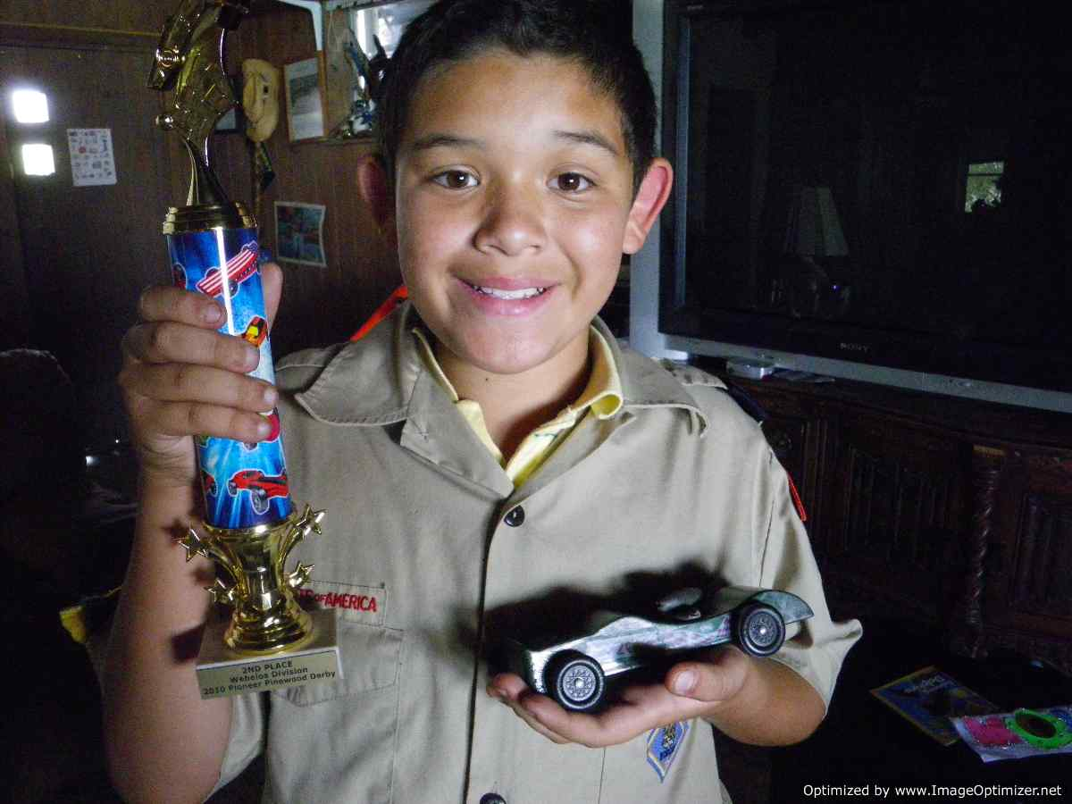 Johnathan at Home with 2nd Place Webelos Trophy